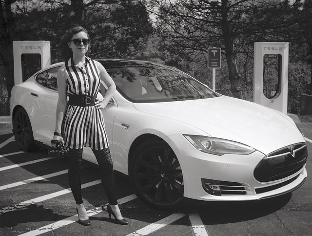 "Public Herald founder Melissa Troutman with a Tesla Model S before she embarks on a national tour of her documentary ""Triple Divide"" on fracking. photo: jbpribanic"